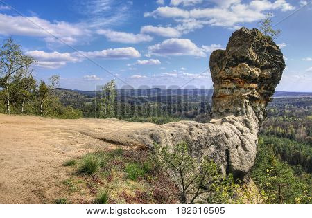 Capska cudgel - rock formation on a rocky promontor, Czech republic
