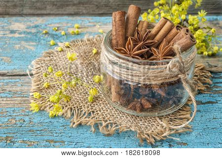 Cinnamon sticks and anise on wooden surface