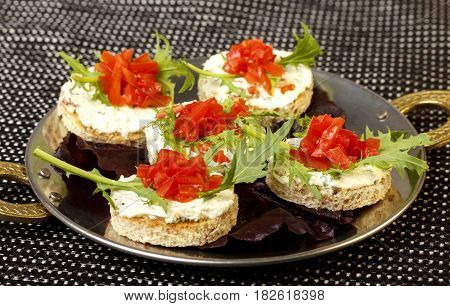 Sandwich with tomato, arugula and cream on isolated white background