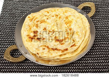 traditional indian home made roti chapati paratha indian flat bread or indian tortilla nan