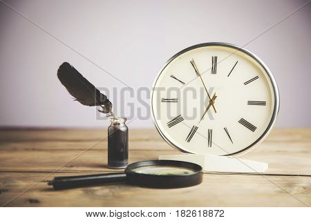 clock Magnifier and ink on wooden table