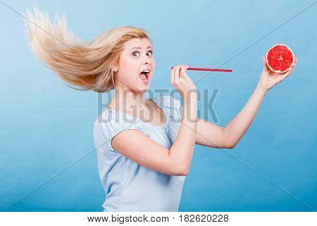 Woman Drinking Juice From Fruit, Red Grapefruit