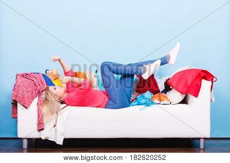 Woman Does Not Know What To Wear Lying On Couch