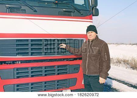 Elderly driver near big modern truck outdoors