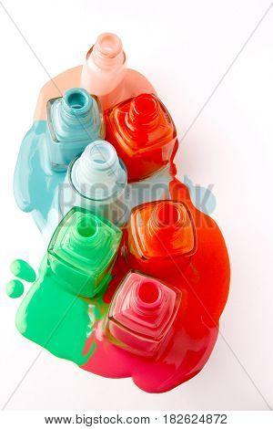 Nails varnish bottles on white background. Colorful