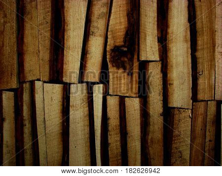 Abstract background. Firewood stacked in several rows