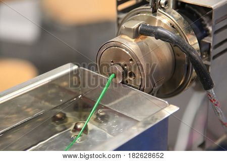 Plastic Wire Filament the Modern printing technology. Continuous extrusion with cooling in water.