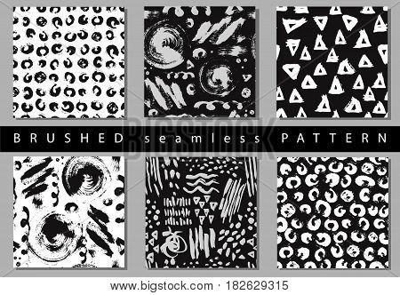 Vector Set of seamless pattern with brush stripes and strokes. Black and white color on background. Hand painted grange texture. Ink geometric elements. Fashion modern style. Endless fabric print