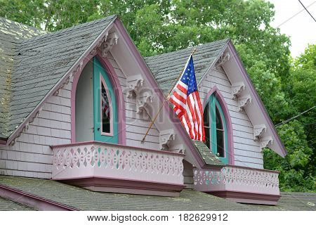 Carpenter Gothic Cottages with Victorian style, gingerbread trim in Wesleyan Grove, town of Oak Bluffs on Martha's Vineyard, Massachusetts, USA.