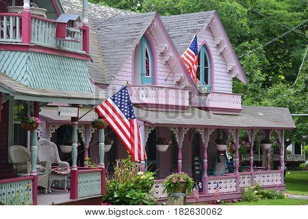 MARTHA'S VINEYARD, MA, USA - JULY. 3, 2015: Carpenter Gothic Cottages with Victorian style, gingerbread trim in Wesleyan Grove, town of Oak Bluffs on Martha's Vineyard, Massachusetts, USA.