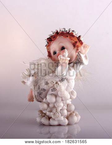 cherub statuette isolated on white background. christmas
