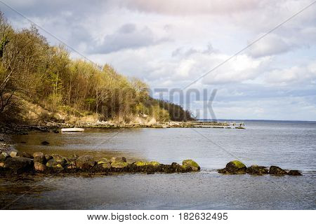 Sea Shore With A Stranded Boat