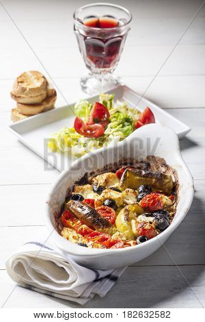 grilled greek feta cheese with tomato and bread