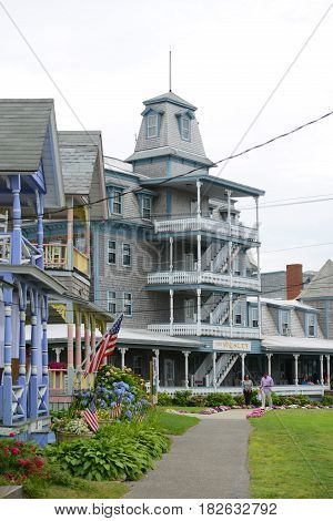 MARTHA'S VINEYARD, MA, USA - JULY. 3, 2015: Carpenter Gothic Cottages with Victorian style, gingerbread trim in Ocean Park, town of Oak Bluffs on Martha's Vineyard, Massachusetts, USA.