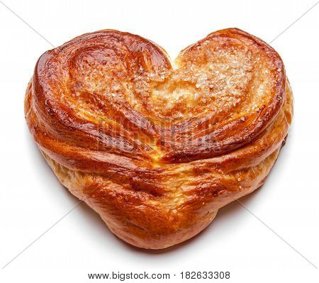 Yeast sweet buns in the shape of a heart on an white. Country house style. Authentically.