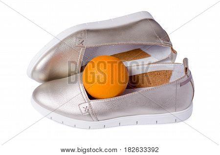 Female silver shoes with orange on white background isolation