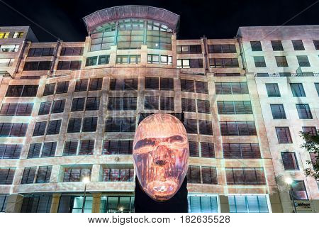 BERLIN - OCTOBER 08 2016: Festival of lights. Historical projection on the facade of the new shopping center
