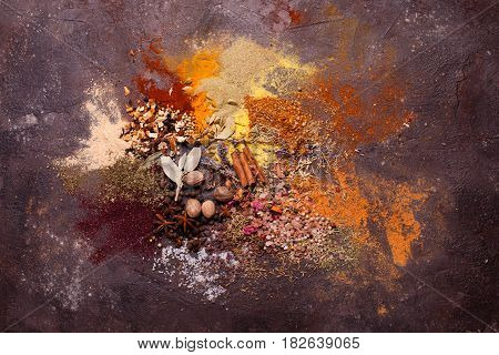 Flat lay composition of various spices as art color abstract painting, top view