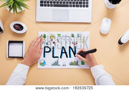Businessperson Drawing Business Plan Chart On Office Desk
