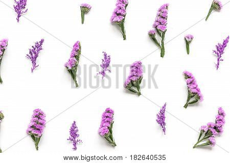 lady morning with mauve flowers on white desk background top view pattern