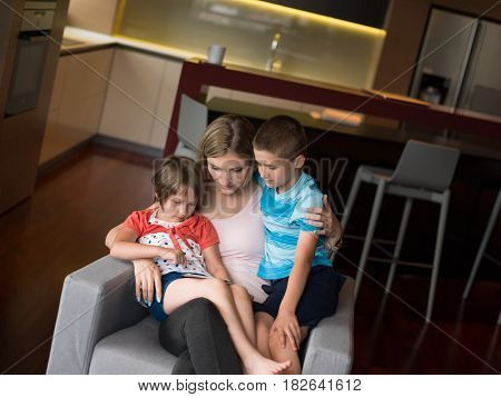 Happy Family Lying Down On The Sofa And Using Tablet