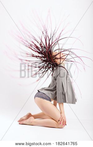 Young slender girl with long afro pigtails dancing