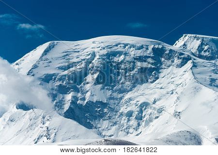 Xinjiang, China - May 21 2015: Mustagh Ata Mountain. A Famous Landscape On The Karakoram Highway In