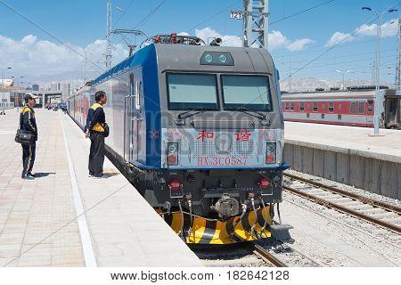 Xinjiang, China - May 29 2015: China Railways Hxd3C Electric Locomotive In Korla Railway Station, Xi