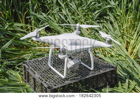 Russia, Poltavskaya village - May 1, 2016: Quadrocopters on a plastic box in the grass. Preparation quadrocopter to fly.