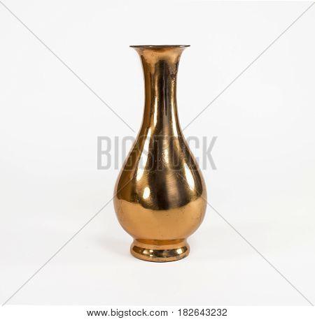 Beautiful copper vase. Isolated on white background