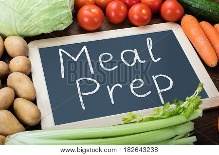 Elevated View Of Fresh Organic Vegetables With Meal Preparation Words Written On Slate