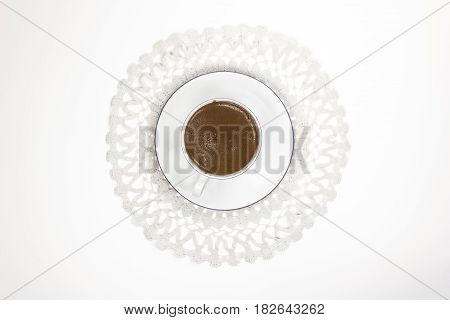 Turkish coffee on lace work top view