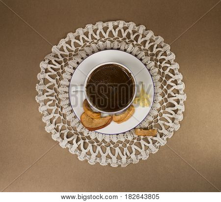 Turkish coffee with dried apple on lace work