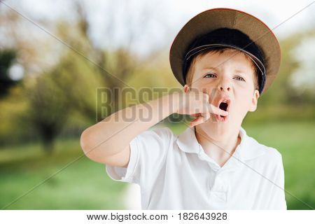 Little Boy Show Emotions At Park Background With Light