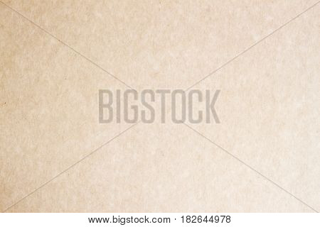 Paper craft texture background. Grunge surface close-up, for design with copy space text or image. Organic cardboard texture close-up, with various villi, fluff and other inclusions. Natural rough textured paper background