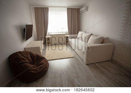 Room interior, beautifully decorated living room in beige tones