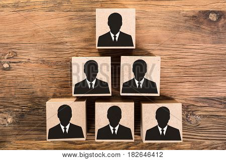 Elevated View Of Wooden Candidate Pyramid On Wooden Table