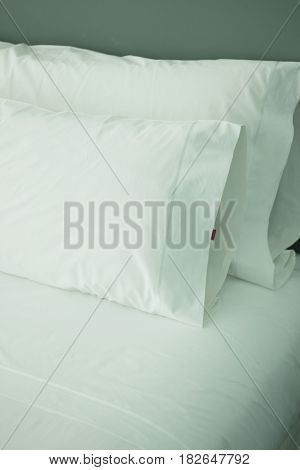 Luxury five star hotel bedroom bed sheets and linen clean and pressed with room ready and cleaned.