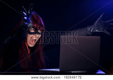 Young woman hacker at night