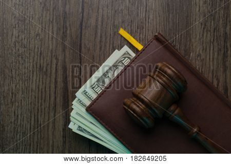 Hammer on folder with banknotes