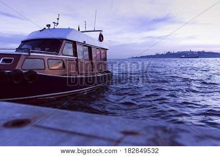 Passenger boat and phosphorus at sunset - Istanbul