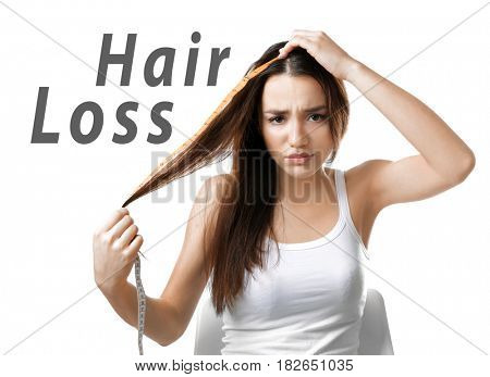 Hair loss concept. Young woman with measuring tape on white background