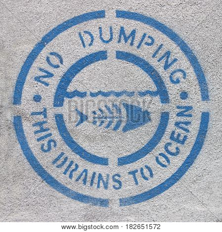 No dumping This Drains to Ocean sign.