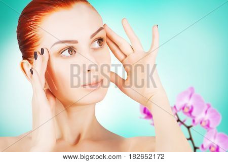 skin lifting concept red haired woman with flowers