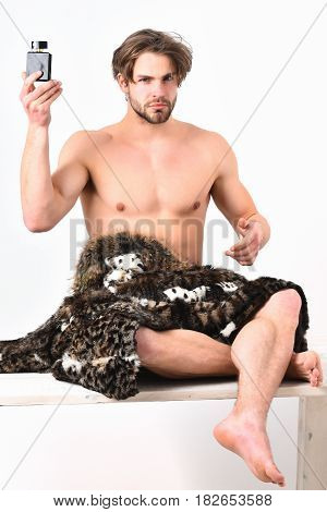 Bearded Macho Man With Fur Coat On White Background
