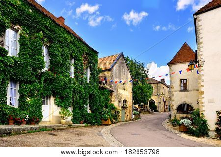 Leafy Lane In A Picturesque Medieval Village In Burgundy, France