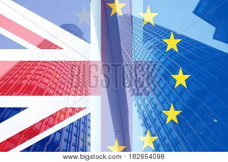 flags of UK and EU on reflecting skyscrapers in London - financial crisis after Brexit