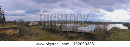 view to overcast landscape with the pond