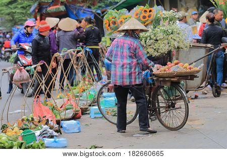 HANOI VIETNAM - NOVEMBER 24, 2016: Unidentified people visit Old Quarter district