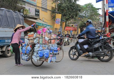 HANOI VIETNAM - NOVEMBER 24, 2016: Unidentified people visit Old Quarter district.